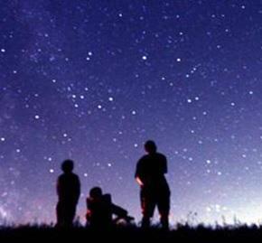 People gazing up at night sky.